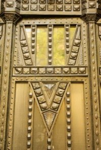 3096521-geometric-design-in-wrought-iron-on-the-door-of-an-art-deco-apartment-house-in-budapest