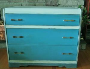 Teal blue and off-white dresser $125.00